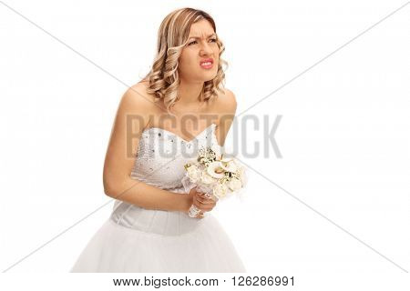 Studio shot of a young bride experiencing pain in her abdomen isolated on white background