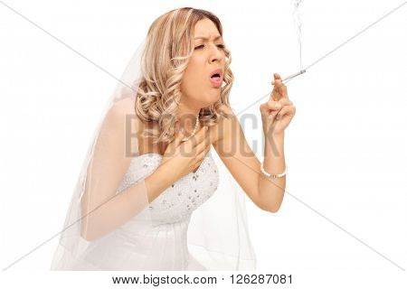 Blond bride smoking a cigarette and coughing isolated on white background