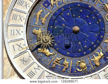 Detail from Saint Mark clocktower in the center of Venice with zodiac signs and roman numbers