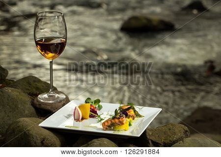 Wine Glass And Meal Near Water