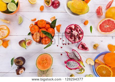 Citrus fresh fruits on a wooden table, close-up.