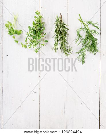 Fresh herbs on wooden background, close-up.