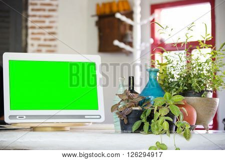 Stylish workplace in office with green screen on monitor for add your text