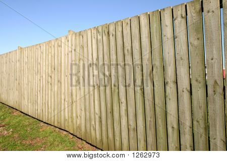 A Large Wooden Perimeter Fence.