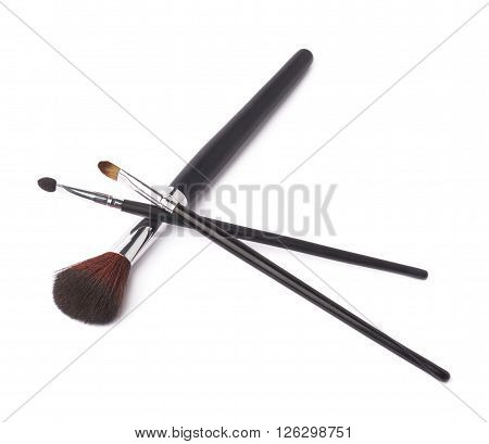Composition of three different makeup brushes isolated over the white background