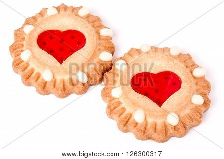 two cookies with marmalade heart isolated on white background.