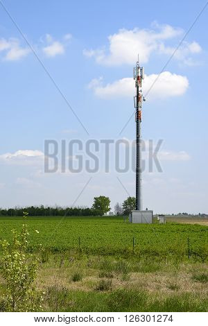 Radio transmitter tower in the middle of a field