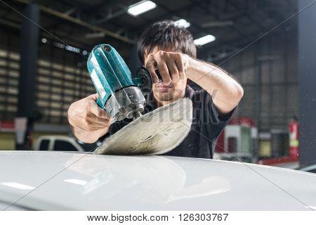 Car detailing series : Man polishing white car