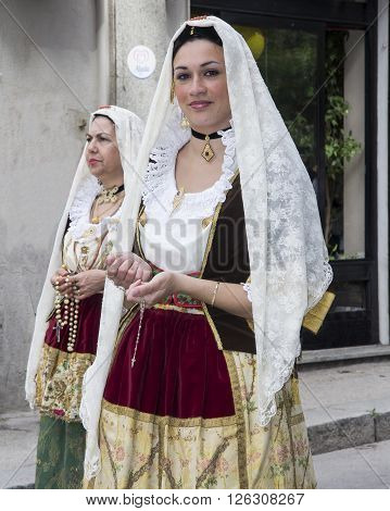 CAGLIARI, ITALY - May 1, 2013: 357 ^ Religious Procession of Sant'Efisio - Sardinia - Portrait of a beautiful girl in traditional costume of Sardinia