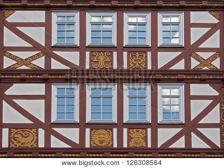 NEU ANSPACH, GERMANY - APRIL 18, 2016: old half timbered house facade with ornaments