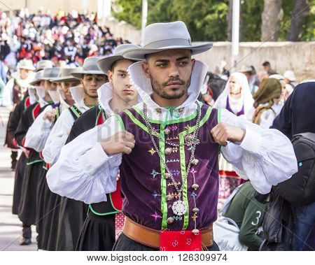 CAGLIARI. ITALY - 2015 May, 1: 359 ^ Religious Procession of Sant'Efisio - Sardinia - Young people who parade through the streets of the city of Cagliari in traditional costumes of Sardinia