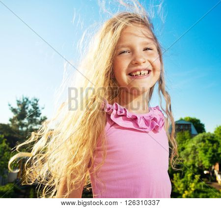 Happy smiling child at summer. Laughing girl