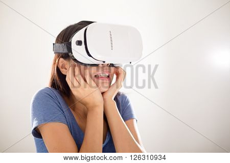 Asian Woman watching scary movie with VR device