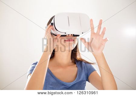 Asian Woman watching with VR device and hands up