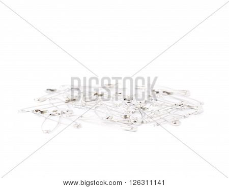 Pile of metal safety pin isolated on white background
