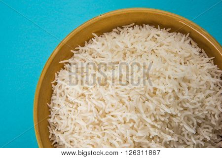 cooked white rice in a bowl, plain basmati rice, cooked basmati rice served in ceramic bowl