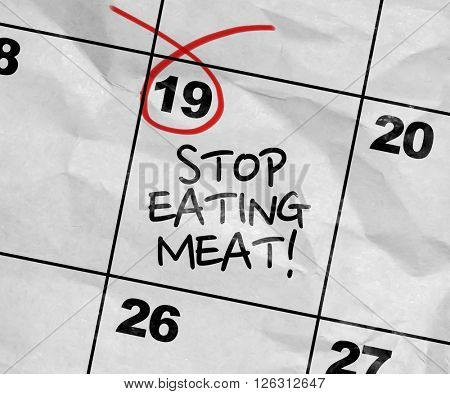 Concept image of a Calendar with the text: Stop Eating Meat