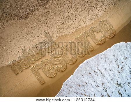Natural Resource written on the beach