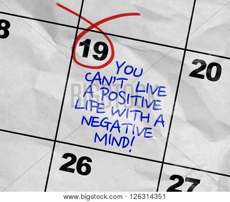 Concept image of a Calendar with the text: You Cant Life a Positive Life With a Negative Mind