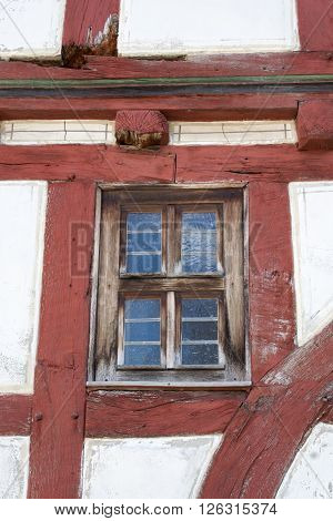 a window in an old half timbered house