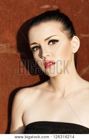 Close-up portrait of beautiful brunette with creative make up