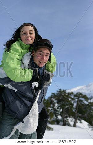 Young man carrying a young woman on his back