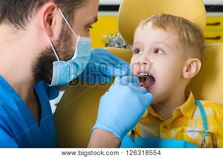 small kid, patient visiting specialist in dental clinic.