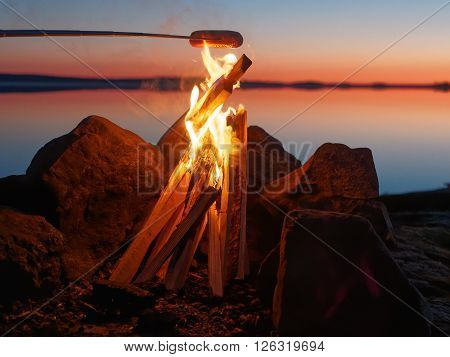 Grilled Sausage On Campfire