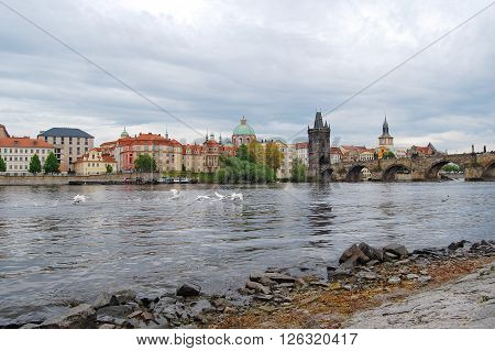 River Vltava. View from the bank to Charles Bridge.