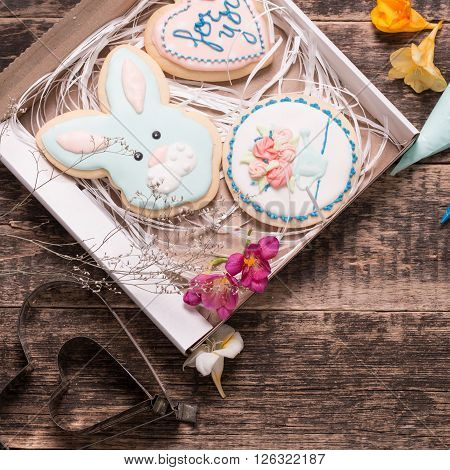 Color Icing Cookie On Wooden Background And Cornets With Glaze For Painting
