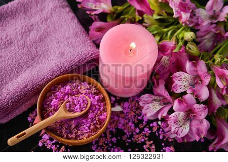 Spa background-towel, orchid, and spoon petals in bowl