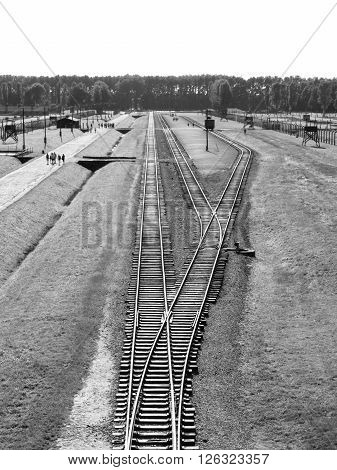 View of railway platform in concentration camp Auschwitz - Birkenau, or Oswiecim - Brzezinka, from gate tower, Poland. Black and white image.
