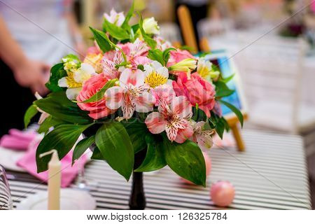 Elegant red flowers bouquet standing on table. Elegant red flowers bouquet standing on table
