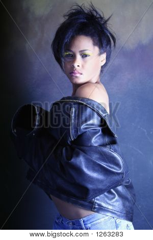 Teenage African American / Black Girl Removing Her Leather Jacket