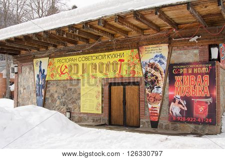 "Dombay, Russia - February 7, 2015: The Restaurant Soviet Cuisine ""hammer And Sickle"" Is Lo"