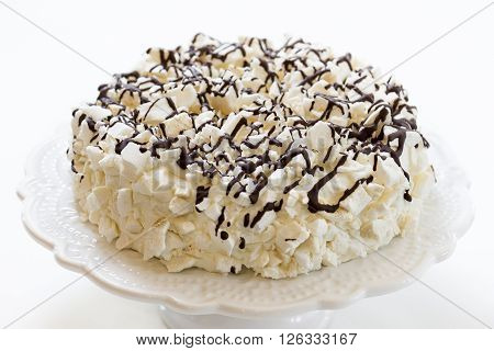 cake with icecream covered with meringue and chocolate