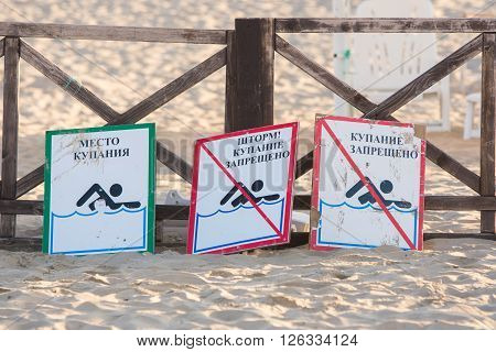 Anapa, Russia - September 21, 2015: Signs - Bathing Place, Storm, Swimming Prohibited And Swimming F
