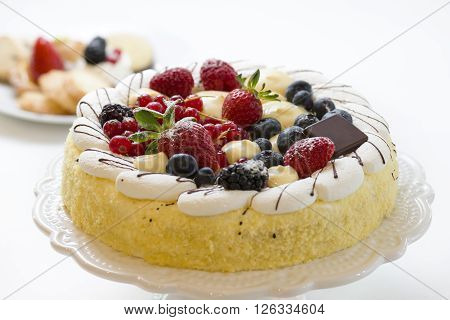 cake pastry decorated with fresh fruits and cream