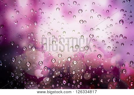 Pink vintage texture raindrops on a windowpane.