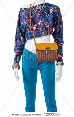 Crop top with bicolor handbag. Bicolor leather purse on mannequin. Trendy crop top and accessories. Selection of woman's summer clothing.