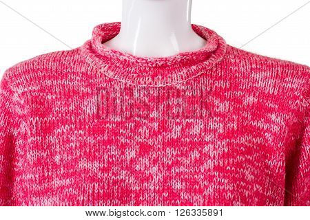 Lady's pink woolen sweater. Bright pullover on white mannequin. Brand new sweatshirt on sale. Colorful garment of warm fabric.