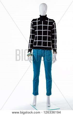 Woman's black checkered sweater. Dark checkered pullover on mannequin. New high-quality sweatshirt. Girl's trendy autumn look.