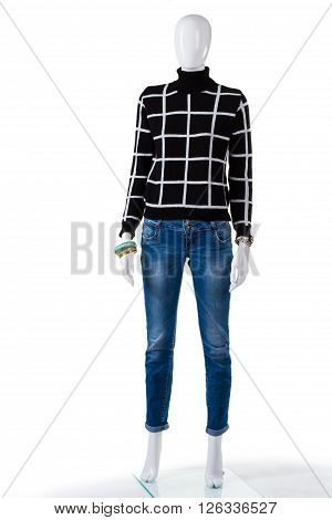 Black checkered pullover with jeans. Mannequin wearing sweatshirt and jeans. Woman's stylish autumn outfit. High-quality denim pants.