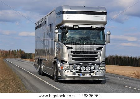 KOSKI TL, FINLAND - APRIL 16, 2016: New modern silver Scania horsebox truck for horse transport on the road at spring.