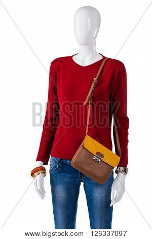 Red pullover with bicolor bag. Sweatshirt and purse on mannequin. Woman's light autumn outfit. Bicolor leather bag in stock.