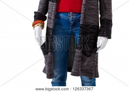 Sweater coat and blue jeans. Long sweater coat on mannequin. Autumn outerwear for ladies. Seasonal sale of trendy apparel.