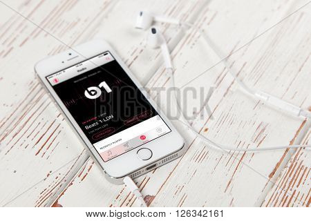 WROCLAW, POLAND - APRIL 12, 2016: Apple iPhone SE smartphone with Apple Music app on screen