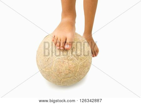 barefoot child with old soccer ball in his feet that isolated on white background