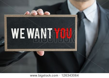 We want you message on blackboard and hold by businessman business concept