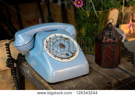 Blue vintage phone, old-fashioned, material, communication, rotary